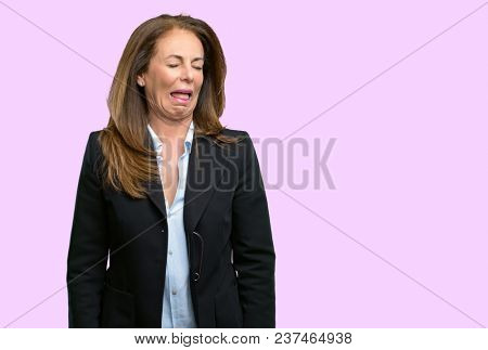 Middle age business woman crying depressed full of sadness expressing sad emotion