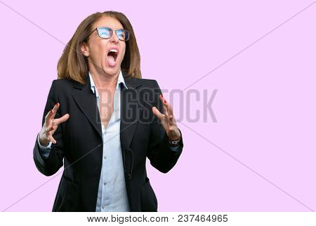 Middle age business woman terrified and nervous expressing anxiety and panic gesture, overwhelmed