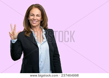 Middle age business woman raising his finger, is the number three