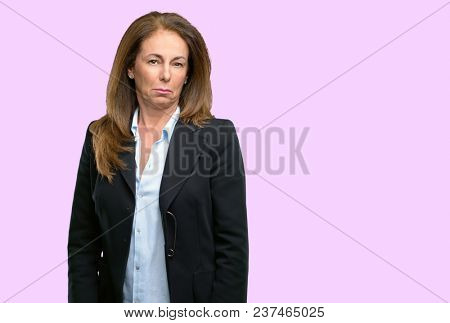 Middle age business woman with sad and upset expression, unhappy