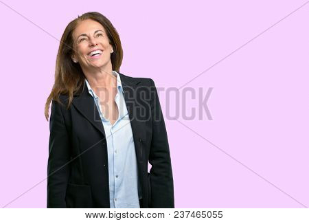 Middle age business woman confident and happy with a big natural smile laughing, natural expression