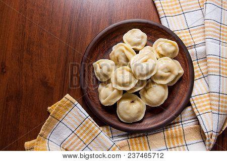 Boiled Ukrainian Meat Dumplings Or Ravioli On Wooden Background.