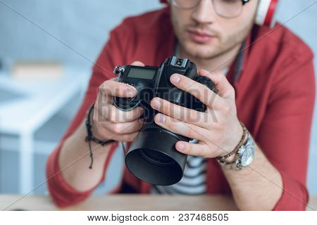 Digital Camera In Hands Of Man Professional Photographer