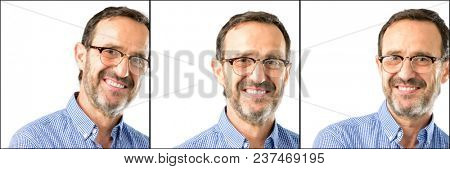 Middle age handsome man closeup confident and happy with a big natural smile laughing, natural expression