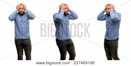 African american man with beard covering ears ignoring annoying loud noise, plugs ears to avoid hearing sound. Noisy music is a problem.