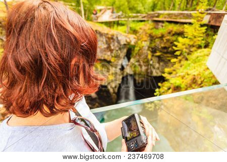 Tourist Attraction In Norway, Europe. Woman Photographer Taking Photo With Camera On Gudbrandsjuvet