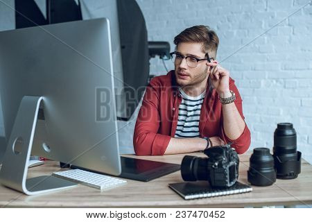 Man Freelancer At Work By Table With Computer And Graphic Tablet