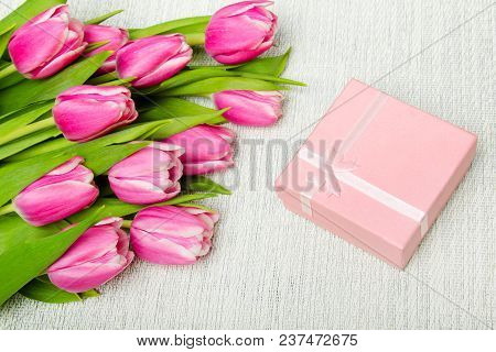 Pink Tulip Bouquet And Small Gift On Light Background,