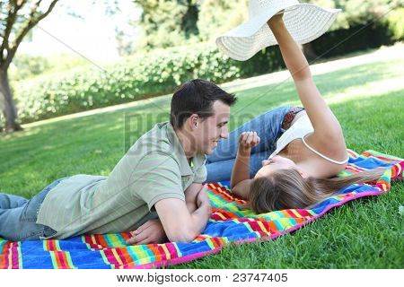 Attractive man and woman couple having fun in the park