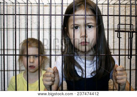 Two Girls Locked In An Iron Cage. Child Crime