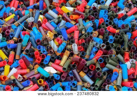 Background Of Many Colorful Shot Empty Shotgun Shells, Blue, Red, Yellow, Purple Colored, Top View