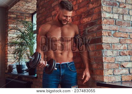 Smiling Handsome Bearded Bodybuilder With Tattoo On His Arm, Doing The Exercises With Dumbbells, Sta