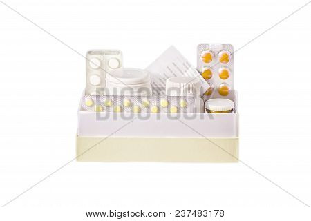 Pills In A Blister And A Plastic Jar In A Cardboard Box