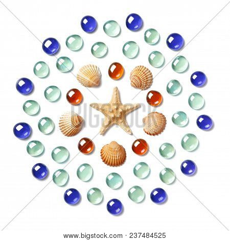Pattern In The Form Of A Circle Made Of Shells, Starfish And Green, Blue And Yellow Glass Beads Isol