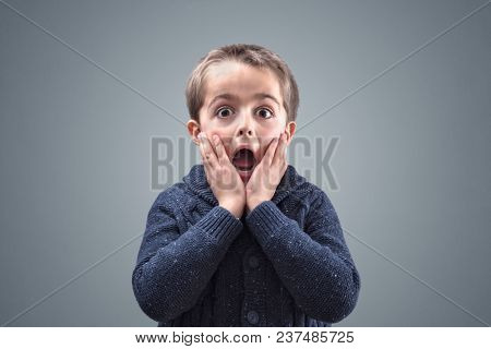 Shocked and surprised boy with copy space concept for amazement, astonishment, making a mistake, stunned and speechless or back to school