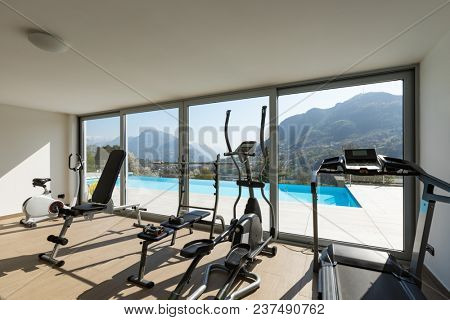 Gym overlooking the pool and hills. Nobody inside