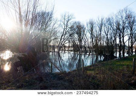 Floodplains Along The Rhine Arnhem, Wageningen, The Netherlands. With Three Silhouettes