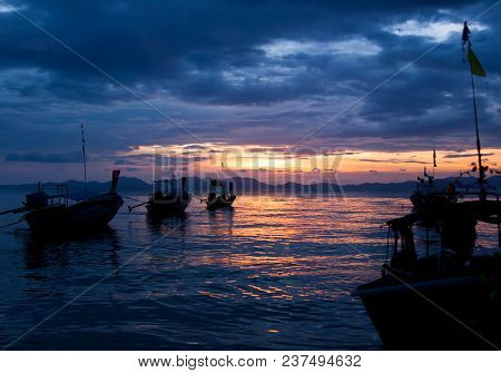 Colorful Seascape With Traditional Thai Boats At Sunset Beach, Scenic Clouds And Shadowy Mountains I