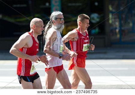 Belgrade, Serbia - April 21, 2018: Runners From Switzerland Taking Part In 31st Belgrade Marathon