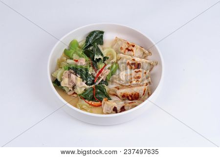 Steamed Stuffing Flour As Gyoza Topped Chinese Kale And Streamed Streaky Pork In Soup With Sliced Ch