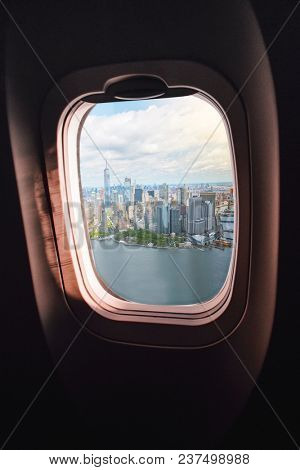 aerial view of Manhatten, New York City, seen through an airplane window