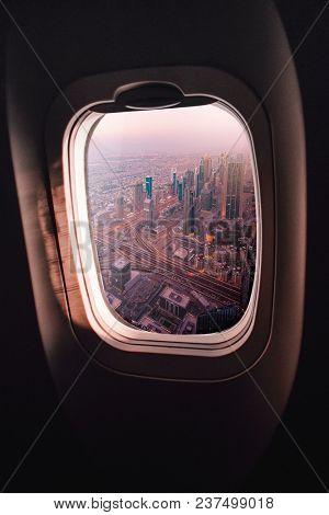 aerial view of Dubai seen through an airplane window
