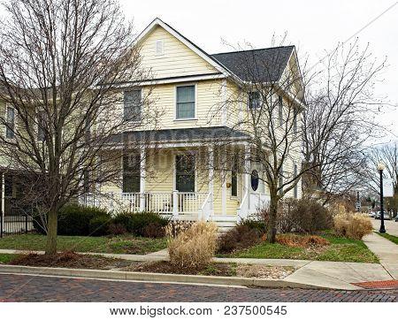 Old Neighborhood Yellow House on Corner