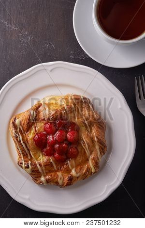 Puff Pastry Tarts With Raspberries On Plate And Cup Of Tea. Top View