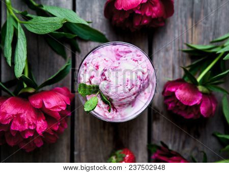 Ice Cream And Peony Flower As Symbol Of Summer And Holiday On Wood Background A