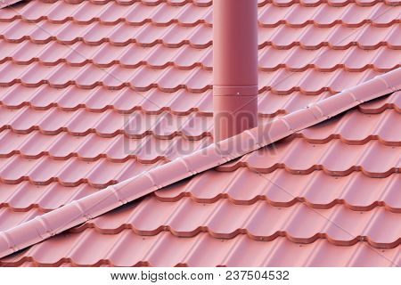 New red Tiled Roof with metal chimney house. Ð¡lose-up texture for construction industry