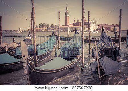 Old Berth With Gondolas Near San Marco Square, Venice, Italy. Venetian Lagoon. Gondola Is A Traditio
