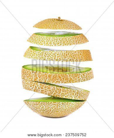 Flying Slices Of Juicy And Sweet Melon, Isolated On White Background. Clipping Path