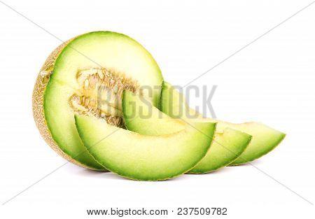 Freshly Sliced Cantaloupe Melon Isolated On White Background. Juicy And Sweet Melon Isolated
