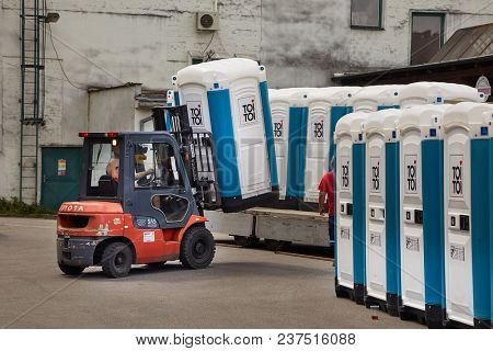 VIZOVICE, CZECH REPUBLIC - JULY 12, 2017: Installing many portable toilets for the Masters Of Rock festival beginning the next day