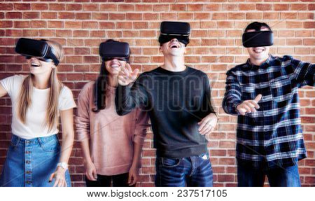 Friends trying on VR headsets