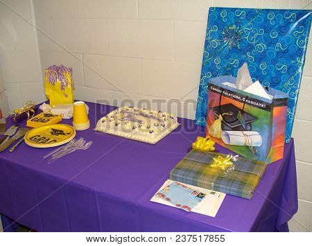 College Graduation Party Desert Table Setup With Cake, Paper Plates, Cups And Presents, Defiance Col