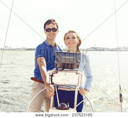 Happy And Beautiful Couple Traveling A Yacht And Enjoying A Day. Summer, Holiday, Vacation Concept.