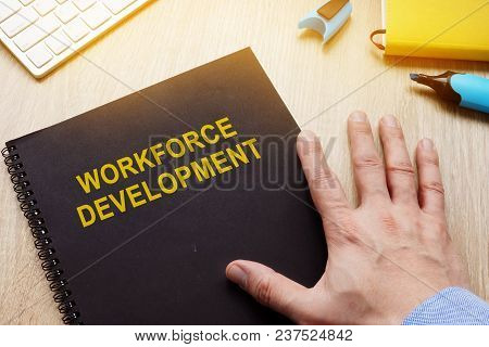 Book With Title Workforce Development On A Desk.