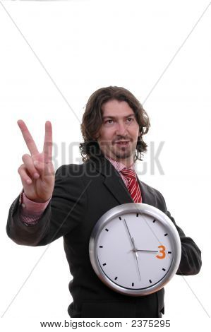 Businessman Holding Wall Clock In Hand