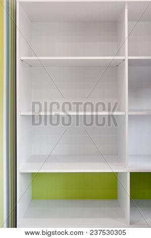 Closeup Of Empty White Wooden Bookshelf In Modern Room