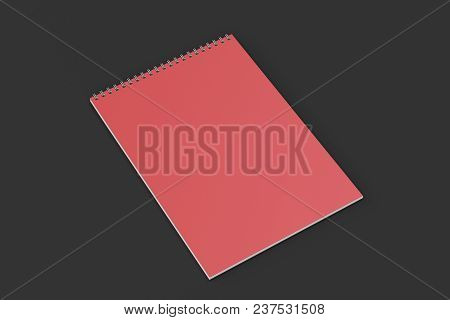 Blank Red Notebook With Metal Spiral Bound On Black Background