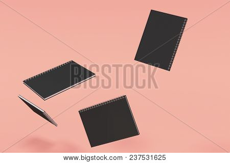 Four Notebooks With Spiral Bound On Red Background