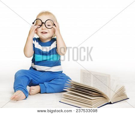 Baby In Glasses Read Book, Early Children Education, Happy Kid Boy One Year Old Sitting Over White B