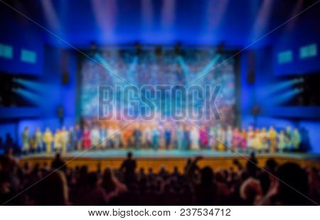 Defocused Image. Auditorium In The Theater During The Performance. The Scenery On The Stage.