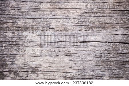 Wooden grey background. Vintage, timeworn, peeled, empty surface, close up view.