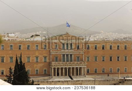 Greece, Athens pollution. UGrey smog over parliament at Syntagma. Sky, hill and town background.
