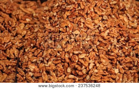 Peeled walnuts kernels background, proper snack for vegan, vegetarian and people on diet. Top view.