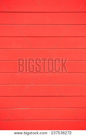 Wooden red background with horizontal planks perfect for celebration concept. Empty surface, close up view.