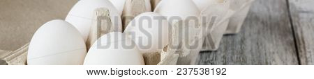 Banner Of Cardboard Egg Rack With Eggs On White Wooden Table