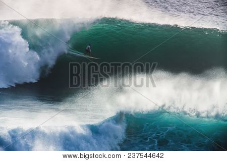 Image Of Surfer On Blue Ocean Big Mavericks Wave In California, Usa. Surfer Riding In Tube. Gun Surf